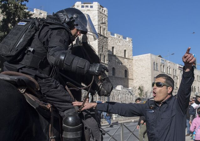 Law enforcement officers during the clashes with protesters in Jerusalem