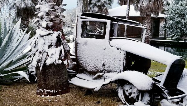 The remains of an old lorry covered with snow are pictured in Santa Fe, Texas, U.S., December 8, 2017 in this picture obtained from social media - Sputnik International