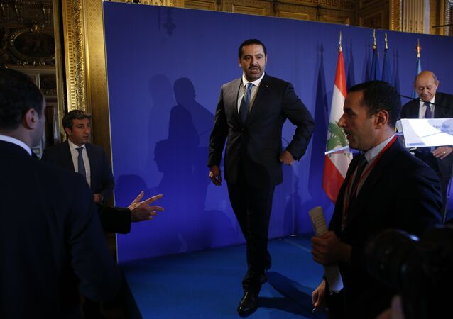 Lebanon's Prime Minister Saad Hariri walks off stage after a press conference held in Paris as part of a summit convened by France to bolster Lebanon's institutions, Friday Dec. 8, 2017. It is the first major gathering of key nations to discuss Lebanon's future since a crisis erupted following Hariri's shock resignation last month while in Saudi Arabia. Hariri has since rescinded his resignation.