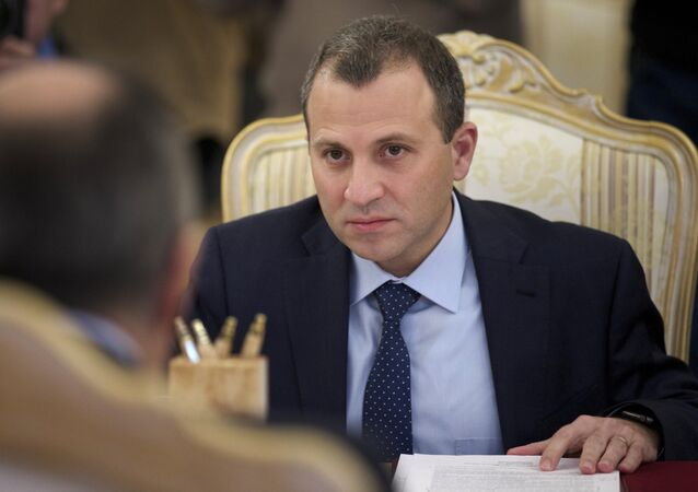 Lebanese Foreign Minister Gebran Bassil listens to his Russian counterpart Sergey Lavrov during their meeting in Moscow, Russia