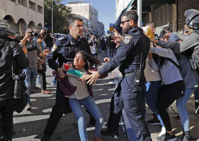 Israeli police disperse Palestinian protesters on December 9, 2017, in East Jerusalem. Retaliatory Israeli air strikes on the Gaza Strip killed two Hamas militants, as unrest simmered across the Palestinian territories over US President Donald Trump's declaration of Jerusalem as Israel's capital