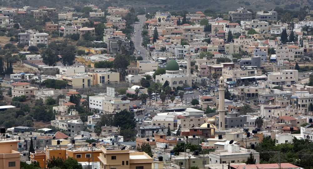 A general view shows the Arab village of Bartaa in Wadi Ara which straddles the Green Line between Israel and the Palestinian territories