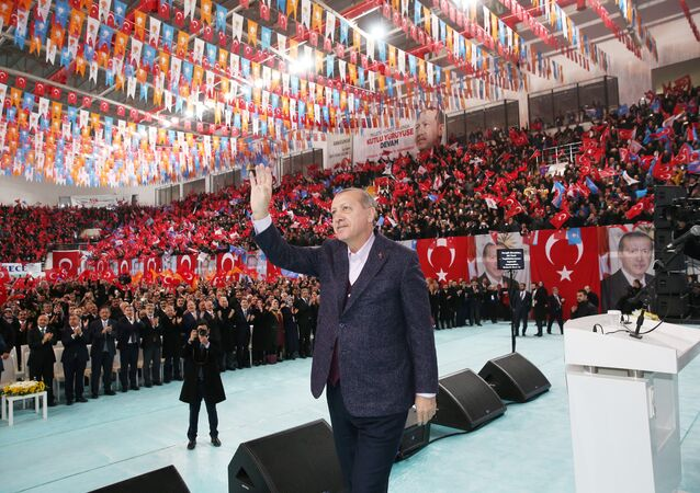 Turkish President Tayyip Erdogan greets his supporters during a meeting of his ruling AK Party in Sivas, Turkey December 10, 2017