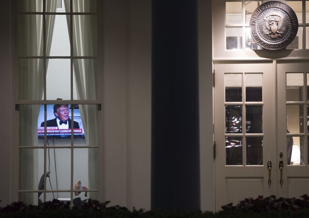 An image of US President Donald Trump appears on a television screen inside the West Wing of the White House in Washington, DC, May 15, 2017