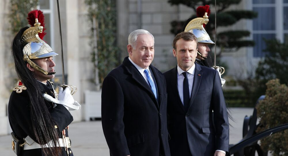 French President Emmanuel Macron, right, greets Israeli Prime Minister Benjamin Netanyahu before a meeting at the Elysee Palace in Paris, Sunday, Dec.10, 2017