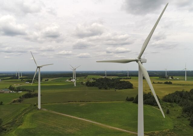 Wind turbines slowly spin in the wind at the High Sheldon Wind Farm,10 July 2017, in Sheldon, N.Y.