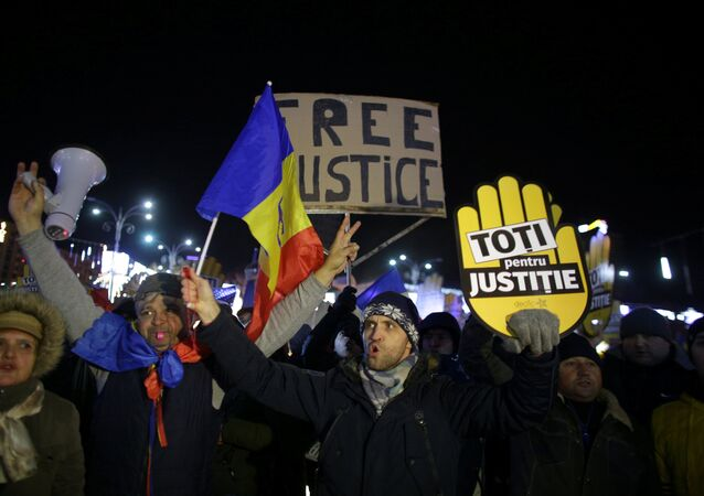 People take part in a demonstration in Bucharest, Romania, December 10, 2017.