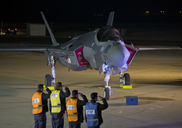 Israeli air force officers salute toward one of the first two next-generation F-35 fighter jets during an unveiling ceremony after it landed in Nevatim Air Force base near Beersheba, Southern Israel, Monday, Dec. 12, 2016