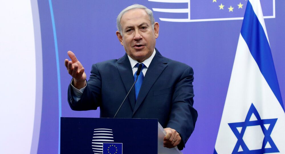Israel's Prime Minister Benjamin Netanyahu briefs the media next to European Union foreign policy chief Federica Mogherini (unseen) at the European Council in Brussels, Belgium December 11, 2017
