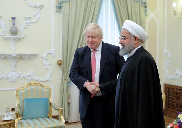 Britain's Foreign Secretary Boris Johnson meets with Iranian President Hassan Rouhani, in Tehran, Iran December 10, 2017