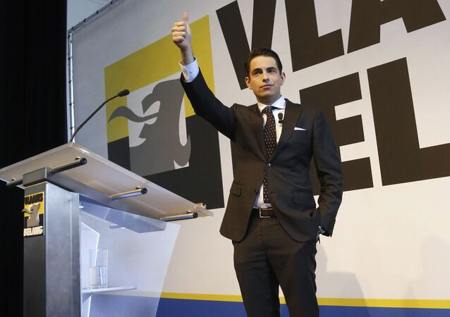 Belgium's Vlaams Belang party chairman Tom Van Grieken gestures during a speech at the new year's wishes of Flemish far-right party Vlaams Belang in Brussels on January 21, 2017