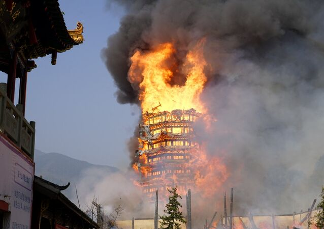 A temple under construction is seen engulfed in fire in Mianzhu, Sichuan province, China December 10, 2017
