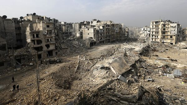 In this picture taken Friday, Jan. 20, 2017 from the balcony of the Abdul-Hamid Khatib home, people walk through mounds of rubble which used to be high rise apartment buildings in the once rebel-held Ansari neighborhood in the eastern Aleppo, Syria - Sputnik International