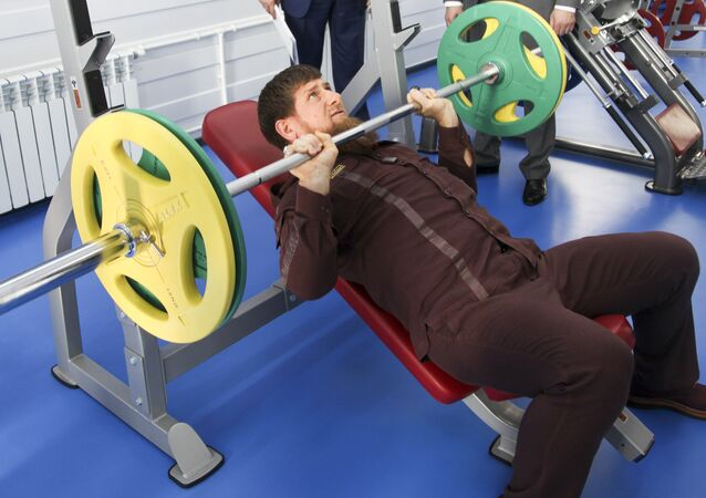 Chechnya's regional leader Ramzan Kadyrov lifts weight in a gym as he visits the Chechen State University in Chechnya's provincial capital Grozny, Russia, Thursday, Aug. 11, 2016