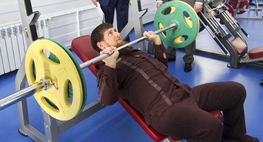 Chechnya's leader Ramzan Kadyrov lifts weight in a gym as he visits the Chechen State University in Chechnya's capital Grozny, Russia, 11 August 2016