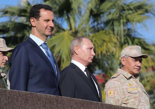 President of Russia Vladimir Putin, President of Syria Bashar al-Assad (left) and Defense Minister Sergei Shoigu at the Hmeymim Air Base in Syria