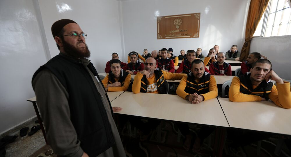 Former Islamic State members sit in a classroom at the Syrian Center for Combating Extremist Ideology in the town of Marea in northern Aleppo countryside, Syria, November 2, 2017. Picture taken November 2, 2017