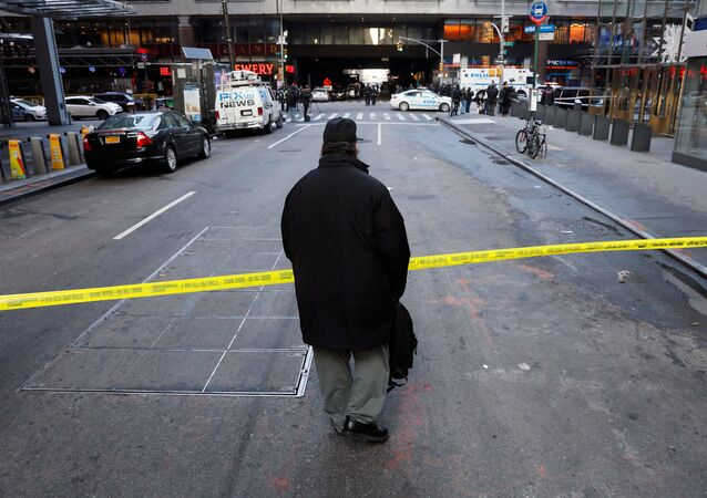 A passer-by looks over the police tape outside the New York Port Authority Bus Terminal in New York City, U.S. December 11, 2017 after reports of an explosion