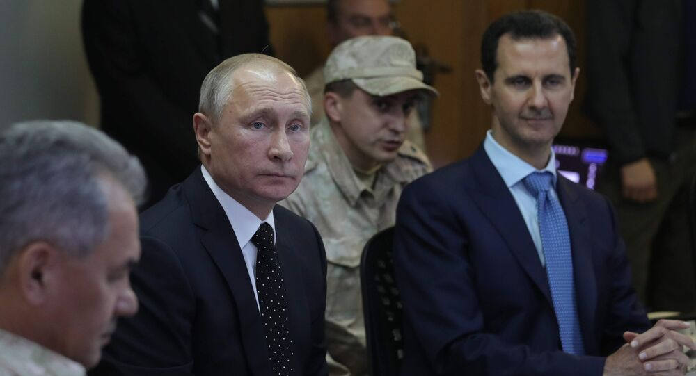 President of Russia Vladimir Putin and President of Syria Bashar al-Assad (right) at the Khmeimim Air Base in Syria