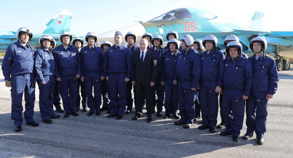 Russian President Vladimir Putin visits the Hmeymim Airbase in Syria on December 11, 2017