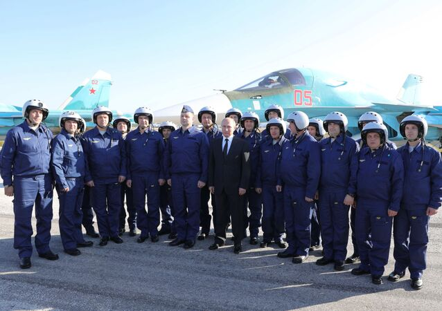 Russian President Vladimir Putin visits the Hmeymim Airbase in Syria on December 11, 2017