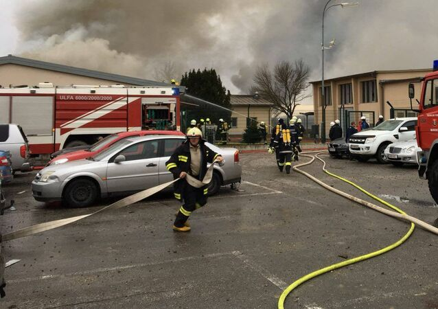 Emergency crews are seen attending to a fire after reports of a gas explosion in Baumgarten, Austria December 12, 2017 in this picture obtained from social media
