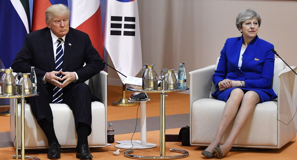 US President Donald Trump and Britain's Prime Minister Theresa May sit at the start of the retreat meeting on the first day of the G-20 summit in Hamburg, northern Germany, on Friday July 7, 2017.