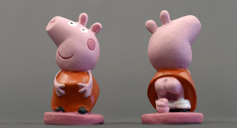 Ceramic figurines of British children's animated TV serie character Peppa Pig called Caganers are pictured during their presentation in Torroella de Montgri, near Gerona on November 15, 2013.