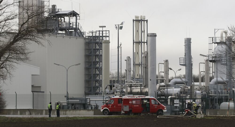 Firefighters stand outside a gas plant after an explosion occured near Baumgarten an der March, Austria, Tuesday, Dec. 12, 2017