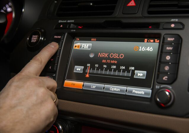 A man looks for a radio station inside a car in Oslo on January 10, 2017