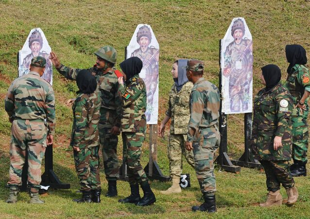 Afghan army cadets take part in a firing excercise during a training programme at the Officers Training Academy in the Indian city of Chennai