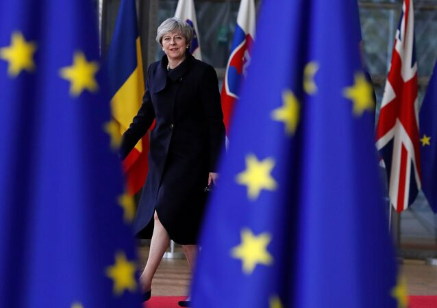 Britain's Prime Minister Theresa May arrives to attend the European Union summit in Brussels, Belgium, December 14, 2017
