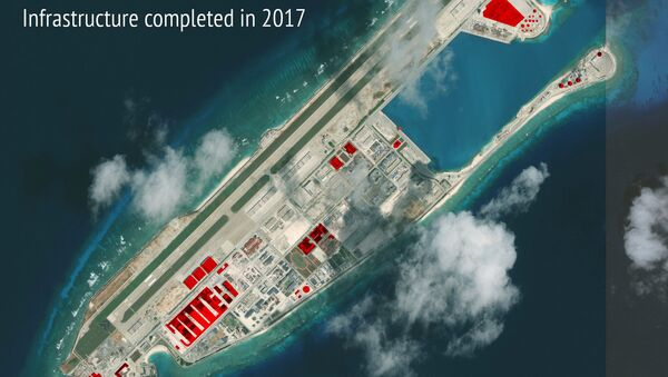 This image provided by CSIS Asia Maritime Transparency Initiative/DigitalGlobe shows a satellite image of Fiery Cross Reef in Spratly island chain in the South China Sea, annotated by the source to show areas where China has conducted construction work above ground during 2017 - Sputnik International