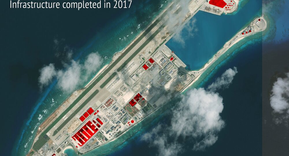 This image provided by CSIS Asia Maritime Transparency Initiative/DigitalGlobe shows a satellite image of Fiery Cross Reef in Spratly island chain in the South China Sea, annotated by the source to show areas where China has conducted construction work above ground during 2017