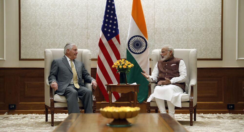 US Secretary of State Rex Tillerson (L) listens to Indian Prime Minister Narendra Modi at the Prime Minister's residence in New Delhi