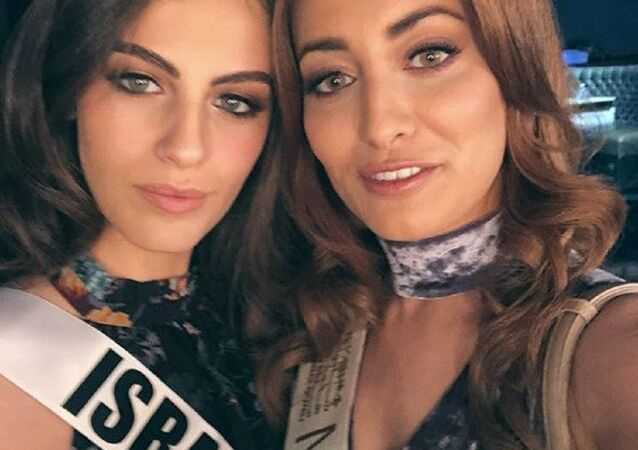 Contestants Miss Iraq, Sarah Eedan (R) and Miss Israel, Adar Gandelsman (L) pose together for a selfie, during preparations for the Miss Universe 2017 beauty pageant in Las Vegas, United States