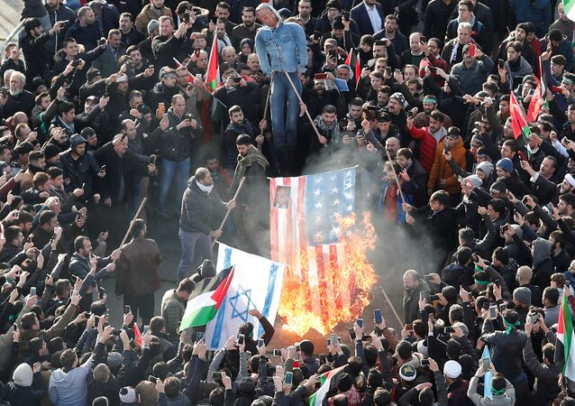 Demonstrators set U.S. and Israeli flags on fire during a protest against U.S. President Donald Trump's recognition of Jerusalem as Israel's capital, in Istanbul, Turkey December 10, 2017