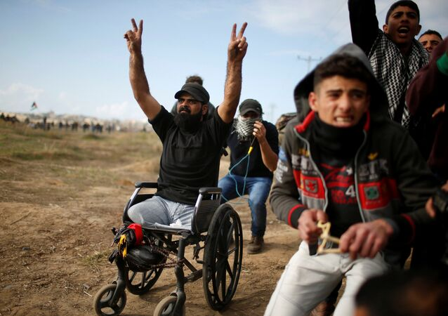 Wheelchair-bound Palestinian demonstrator Ibraheem Abu Thuraya, who according to medics was killed later on Friday during clashes with Israeli troops, gestures during a protest against U.S. President Donald Trump's decision to recognize Jerusalem as the capital of Israel, near the border with Israel in the east of Gaza City December 15, 2017