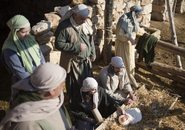 Christian actors play the parts of Joseph and Mary during a re-enactment of a Nativity scene of the birth of Jesus Christ as part of Christmas festivities at the Nazareth Village in the northern Israeli city of Nazareth, Tuesday, Dec. 20, 2016