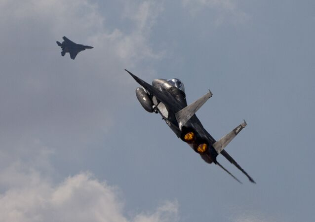 Two Israeli air force F-15s of the Knights of the twin tail 133 squadron fly over Ovda airbase near Eilat, southern Israel, during the 2017 Blue Flag exercise