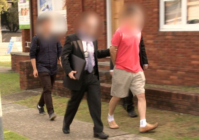 Australian Federal Police (AFP) officers arrest a man during operation BYAHAUT in this handout obtained on December 17, 2017