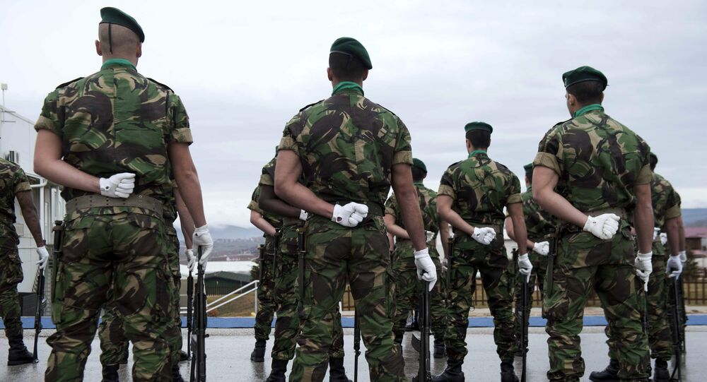 Portuguese soldiers serving in the North Atlantic Treaty Organization (NATO) led peacekeeping mission in Kosovo (KFOR) stand at attention before the arrival of the NATO secretary general during his visit to Pristina on January 23, 2015