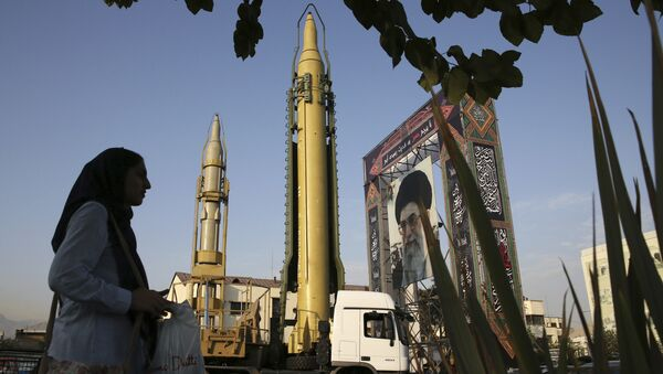 a Ghadr-H missile, center, a solid-fuel surface-to-surface Sejjil missile and a portrait of the Supreme Leader Ayatollah Ali Khamenei are displayed at Baharestan Square in Tehran, Iran - Sputnik International