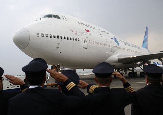 Garuda Indonesia pilots salute during the farewell ceremony for the airline's last Boeing 747 at Soekarno-Hatta International Airport in Tangerang, Indonesia, Monday, Oct. 9, 2017. The country's flag carrier on Monday retired its last serving jumbo jet after decades of service.