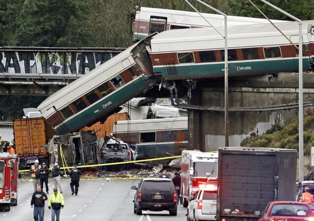 Cars from an Amtrak train lay spilled onto Interstate 5 below alongside smashed vehicles as some train cars remain on the tracks above Monday, Dec. 18, 2017, in DuPont, Wash. The Amtrak train making the first-ever run along a faster new route hurtled off the overpass Monday near Tacoma and spilled some of its cars onto the highway below, killing some people, authorities said. Seventy-eight passengers and five crew members were aboard when the train moving at more than 80 mph derailed about 40 miles south of Seattle before 8 a.m., Amtrak said.