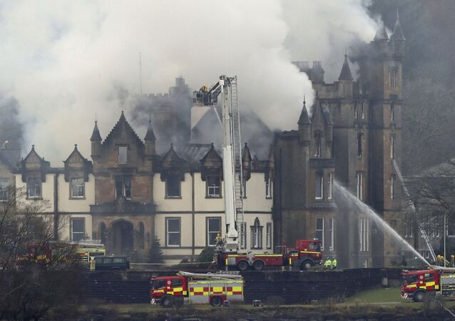 Firefighters attend the scene of a major fire at the Cameron House Hotel on the banks of Loch Lomond in Scotland