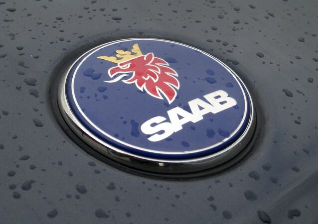 In this Feb. 23, 2009 file picture a Saab logo covered with raindrops is seen on a car in Frankfurt, Germany