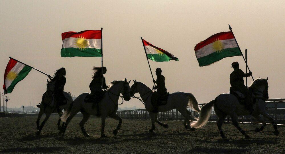 Iraqi Kurdish horsemen ride carrying Kurdish flags celebrating their flag day in the northern city of Arbil, the capital of the autonomous Kurdish region in northern Iraq