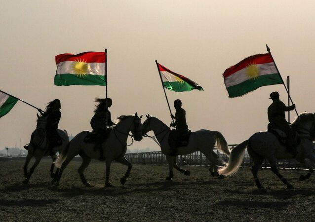 Iraqi Kurdish horsemen ride carrying Kurdish flags celebrating their flag day in the northern city of Arbil, the capital of the autonomous Kurdish region in northern Iraq