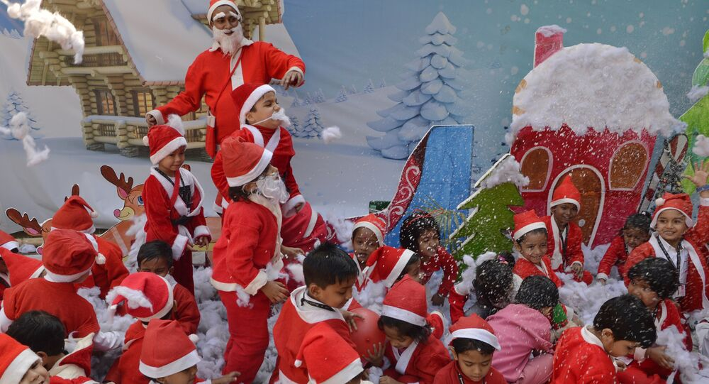 Indian school children dressed as Santa Claus take part in a Christmas event at a school in Siliguri